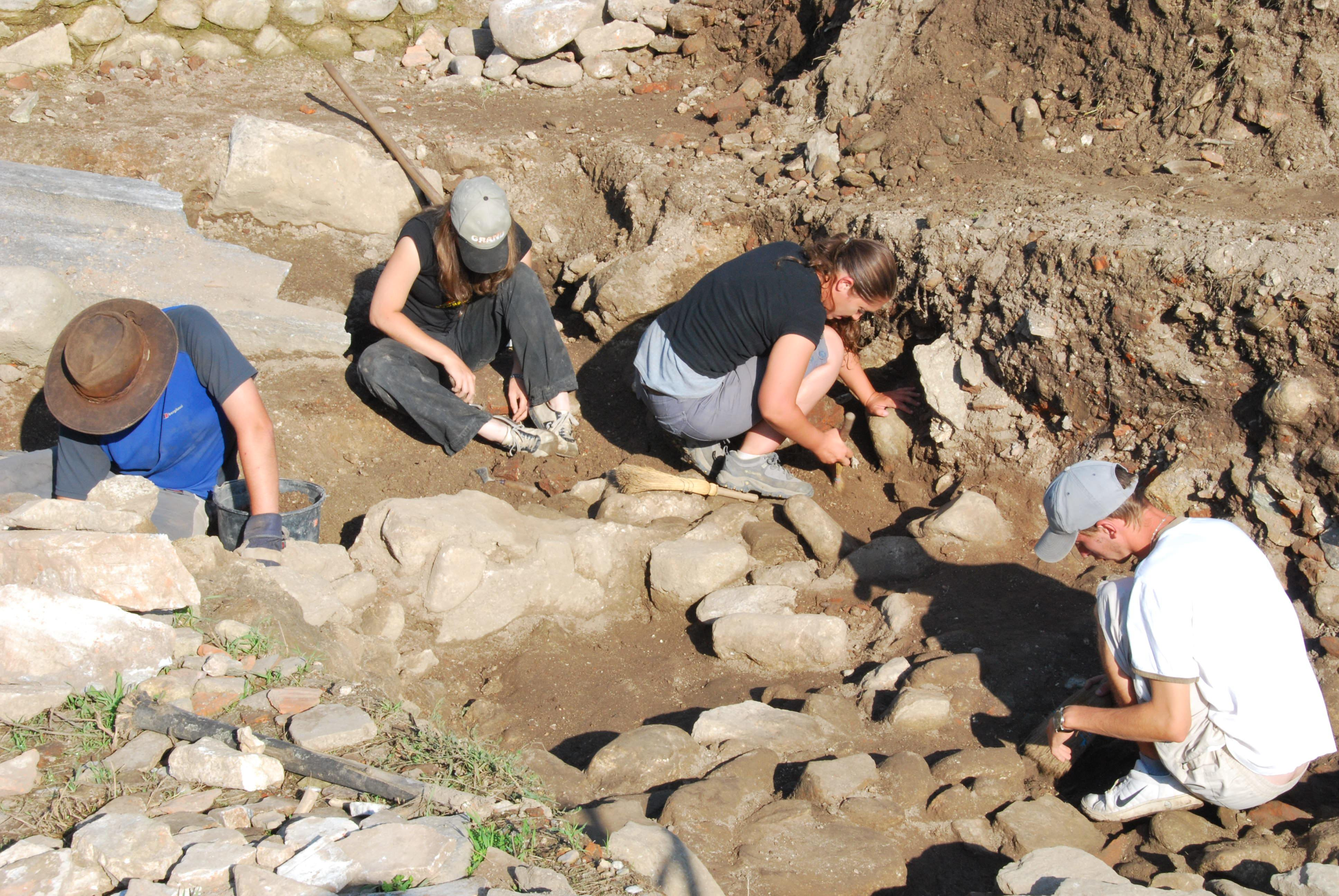 Young volunteers assist with site excavation while Archaeology volunteering in Romania for teens.